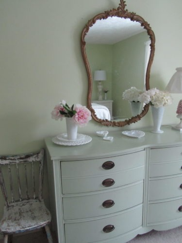 A mirror, chair, and a variety of lighting are good essentials for any guest room.