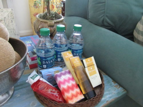 A few little niceties on a tray even by the side of the couch where they will sleep tell a guest you care!