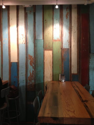 A great wall of texture and color in a eatery in Hawaii.