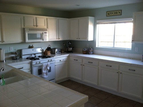 The kitchen after the walls and cabinets were painted and hardware added.